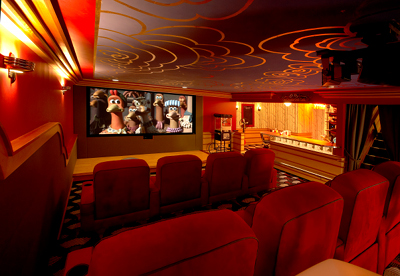 The home theater features a Runco 3D-capable DLP projector, a 10-foot-wide Screen Excellence display, and B&W speakers.